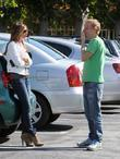 mike white talking to a friend in a parking lot in