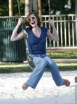 Milla Jovovich  enjoys the swings at the...