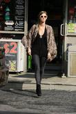 Nicky Hilton is seen filling up and paying...