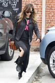 Olivia Wilde dressed casually in a long black...