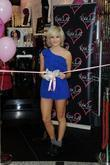 Pixie Lott cuts the ribbon and unveils her...