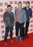 Guy Berryman, Chris Martin and Johnny Buckland of...