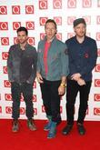 Jonny Buckland, Chris Martin and Guy Berryman of...