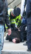 A man is arrested by the police after...