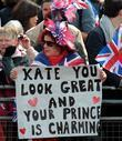 Woman with a sign that says 'Kate You...