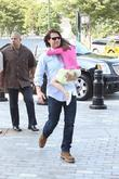 Tom Cruise carries Suri Cruise out of their...