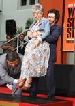 Rita Moreno, George Chakiris and Grauman's Chinese Theatre