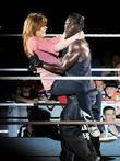 R Truth carries a fan WWE RAW Wrestling...