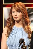 Jennifer Lawrence announces the nominees during the 84th...