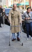 Henry Silva walking with a Zimmer Frame to...