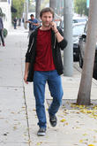breckin meyer talks on his mobile phone while walki