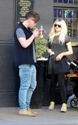 Aidan Grimshaw smoking a cigarette outside a pub...