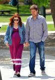 Pregnant Alyson Hannigan at the park with husband...