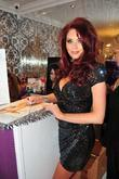 Amy Childs  at her salon to sign...