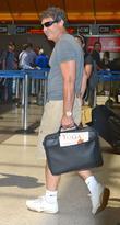 Antonio Banderas  carrying Yoga magazine in his...