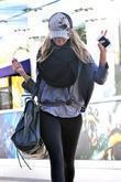 Ashley Tisdale keeps her head down obscuring her...