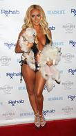 Television personality Aubrey O'Day with her pet dogs...