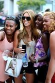 Audrina Patridge poses for a photo with fans...