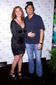 Elizabeth Perkins and Ray Romano