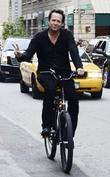 Dean Winters rides his bike in New York...