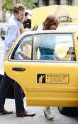Kathy Griffin  getting into a cab in...