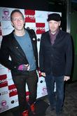 chris martin and jonny buckland of coldplay coldpla