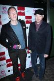 Chris Martin, Jonny Buckland and Coldplay