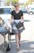 Dianna Agron wearing a floaty skirt as she...