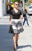 Dianna Agron wearing a floaty skirt while out...