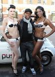 Dizzee Rascal and models attend the launch of...