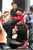 mario lopez along with kevin clash and his puppet e