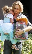 Gabriel Aubry carries a tired looking Nahla Aubrey...