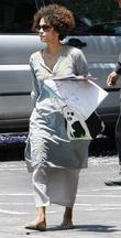 Halle Berry carrying some of her daughter's artwork...