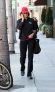 Allison Janney chats on her cellphone whilst out...