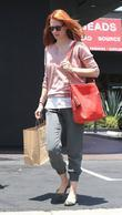 January Jones takes her son shopping for shoes...