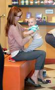 January Jones takes her son Xander shopping for...