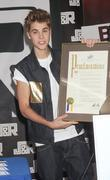 Justin Beiber is presented a proclamation declaring June...
