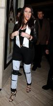 Khloe Kardashian-Odom makes her first solo appearance to...