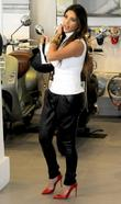 Kim Kardashian at a Vespa store during filming...