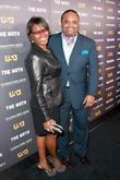 Roland Martin (R) attend the USA Network's and...