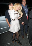 pamela anderson and friends leave the apollo victor