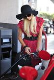 Paris Hilton in a co-ordinated red dress at...