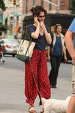 actress parker posey seen on her phone while walkin