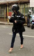 Amanda Holden wearing a motorcycle helmet outside the...