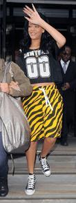 Rihanna leaving her hotel in tiger print shorts...