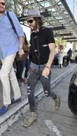 Russell Brand arrives at LAX airport dressed in...