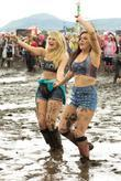 Girls dancing in the mud T in the...