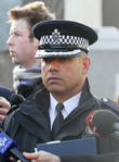 Police speak to waiting reporters