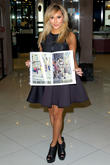 Adrienne Bailon attends the launch of Raine Magazine