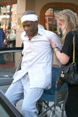 Sidney Poitier leaving a medical building